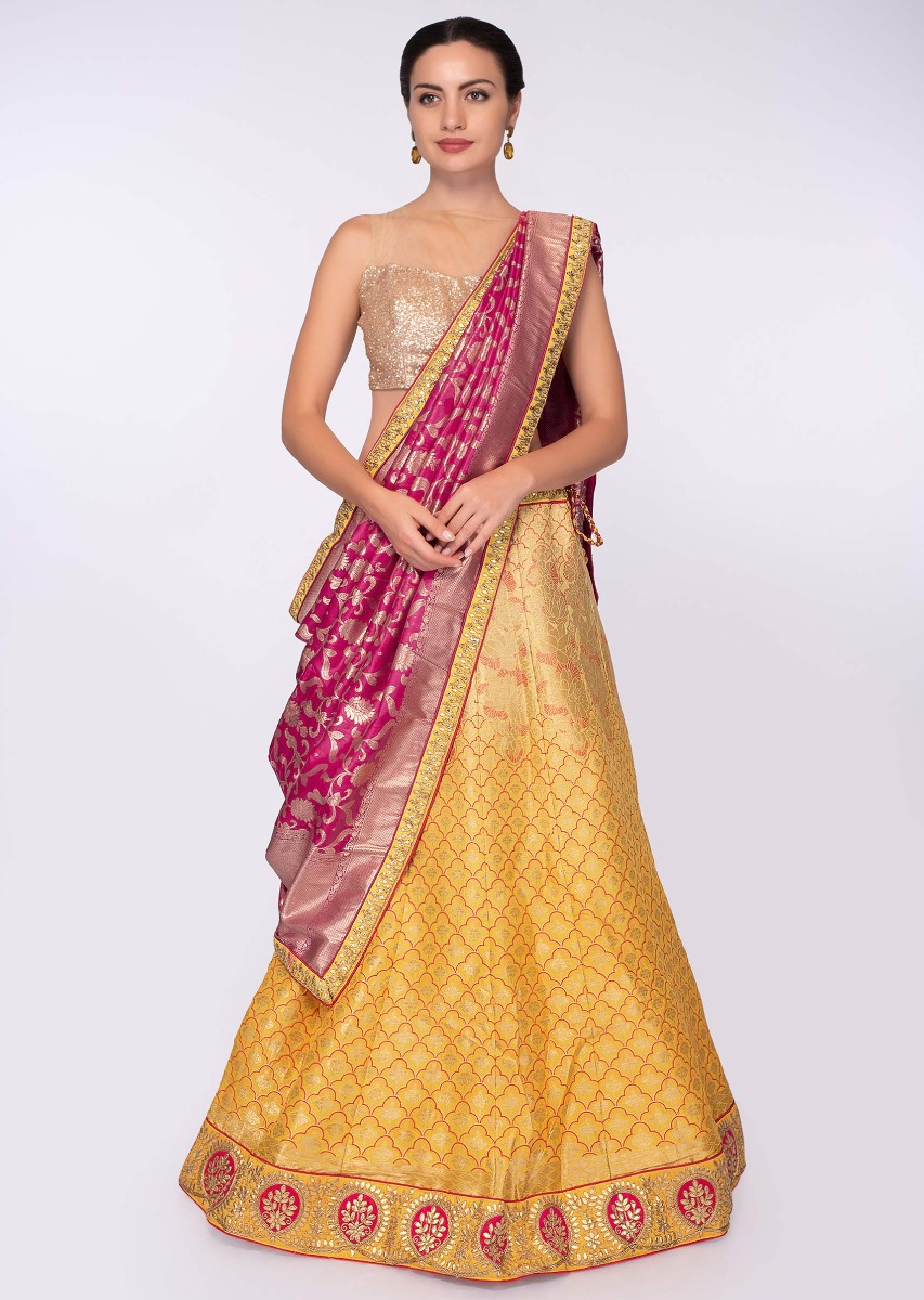 5e572ba1e9 Chrome yellow banarasi silk lehenga paired with fuchsia pink banarasi silk  weaved dupatta only on KalkiMore Detail