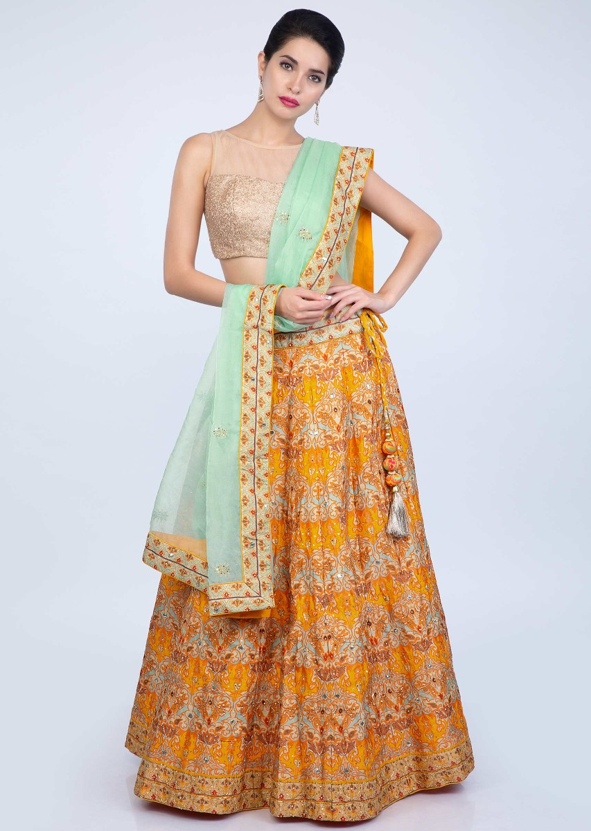 effe6096b7 Chrome yellow patola printed cotton silk lehenga paired with sea green  organza dupatta only on KalkiMore Detail