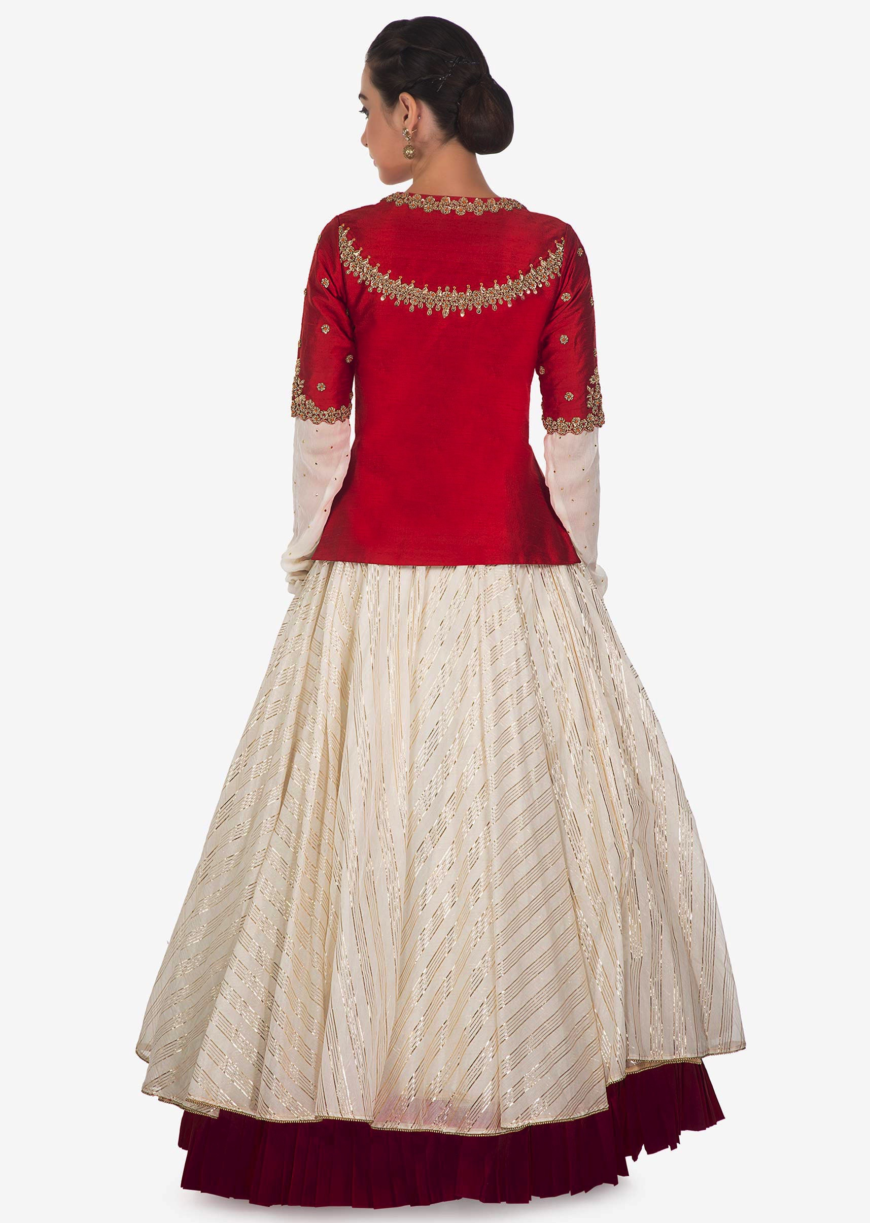 9e75d9d3812069 Cream lehenga matched with red raw silk embroidered jacket blouse only on  Kalki