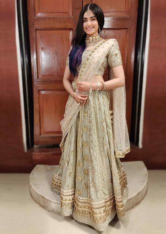 f3bfc83555 Adah Sharma in kalki pista green heavy embellished lehenga set with  contrasting peach net dupatta .