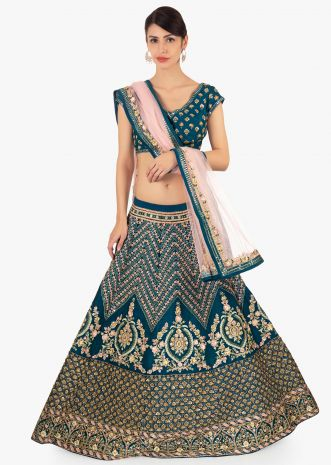 Admiral blue raw silk lehenga in geometric motif paired with matching blouse and pink net dupatta only on Kalki