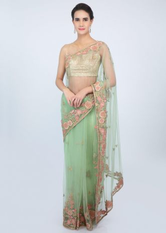 Apple green sheer net saree with floral  embroidered butti and border only on kalki