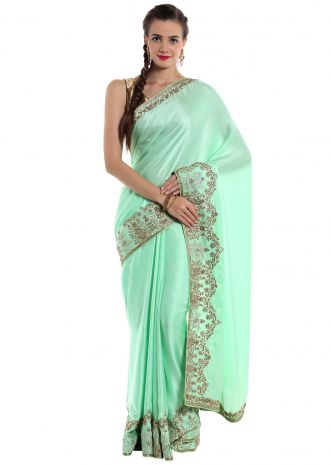 Aqua blue satin saree decorated with ornate zardosi work only on Kalki