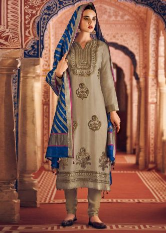 Beige straight suit in silk with embroidered placket and butti