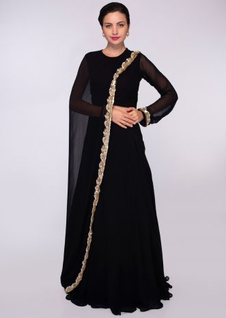 Black georgette top with one side sleeves and additional top paired with a matching skirt