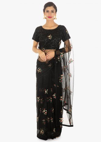 Black net thread embroidered saree paired with a shimmery sequins blouse