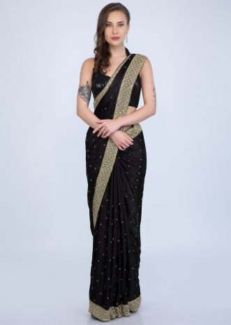 75f13cd094 Black satin chiffon saree with golden cut dana and sequins embroidered  border only on Kalki ...