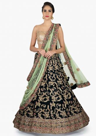 Bottle Green Lehenga Paired up with Pista Green dupatta enhanced in Zari and Sequins only on Kalki