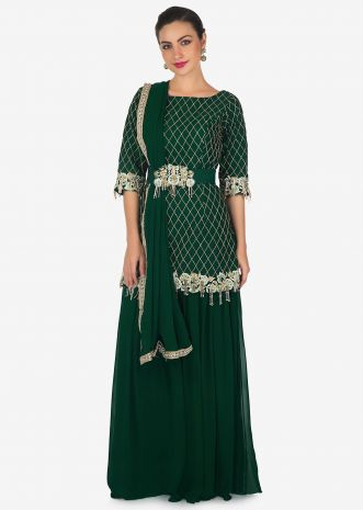 Bottle green palazzo suit beautified in resham and embroidered tassel embroidered work only on Kalki