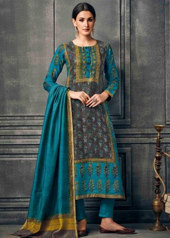 Brown and turq blue suit in silk with floral printed butti and border