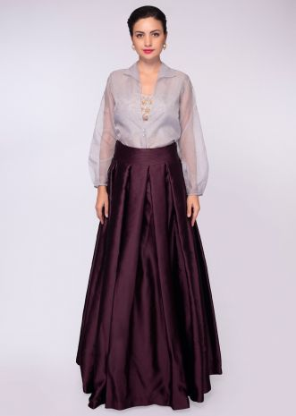 Burgundy satin crepe skirt paired with strapless satin crop top and grey organza jacket