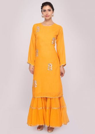 Butterscotch yellow sharara pant paired with maching long suit only on Kalki