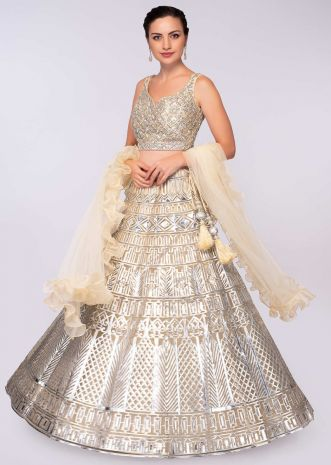 Champagne cream net applique lehenga with matching blouse  only on Kalki