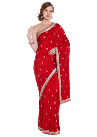 Cherry red silk saree adorn in zari butti and border only on Kalki
