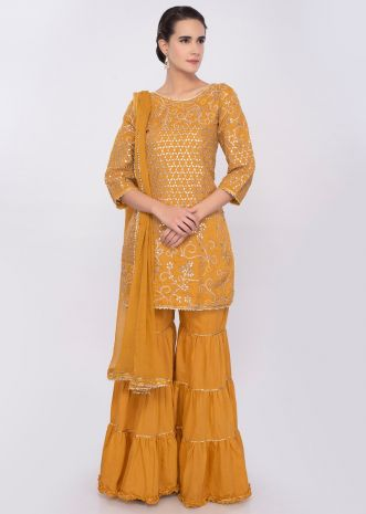 Chrome yellow embroidered cotton silk sharara suit set only on Kalki
