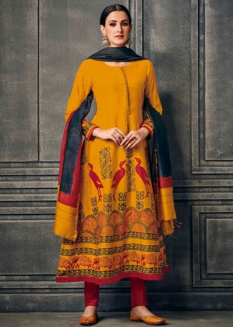 Chrome yellow suit with printed hem line and contrast jade green dupatta