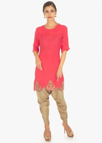 Coral pink silk top paired with a brown cotton dhoti pants