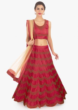 Coral red raw silk lehenga set paired with beige net dupatta
