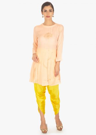 Cotton peach top paired with yellow satin Dhoti