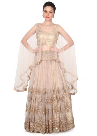 Cream embroidered lehenga matched with cape only on Kalki