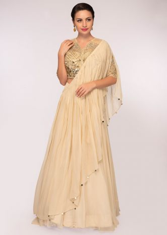 Cream georgette lehenga paired with embroidered net blouse