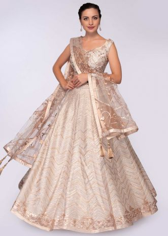 Cream raw silk lehenga paired with a matching blouse in applique work only on Kalki