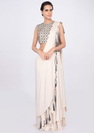 Cream shimmer lycra skirt with matching blouse and prestitched dupatta only on kalki