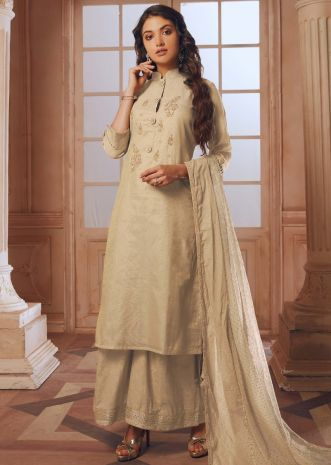 Cream straight palazzo suit in silk with embroidered butti and fancy buttons