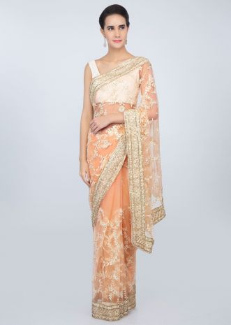 Creamish peach sheer net saree in white thread embroidered jaal work only on kalki