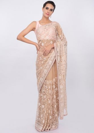 Dark cream net saree with floral jaal embroidery only on kalki