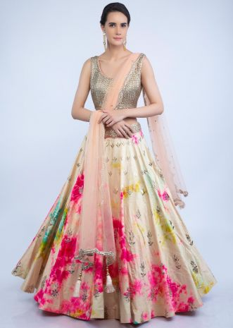 21fcf84746 Dark cream tie and dye lehenga with metallic bead studded blouse and peach  net dupatta only .