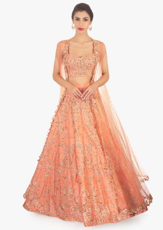 Dark peach lehenga set paired with a fancy net jacket