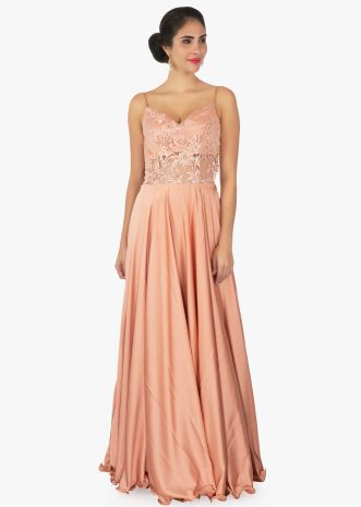 Dark peach satin gown with spegatti strap and sheer waistline and back