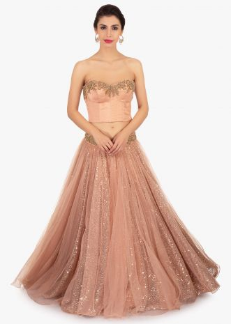 Dark peach strapless crop top paired with sequins fabric skirt