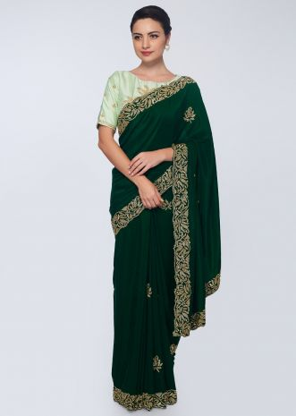 Emerald green satin saree embellished with cut dana embroidered butti and border