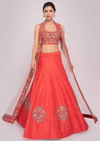 Floral embroidered coral lehenga set paired with long net jacket