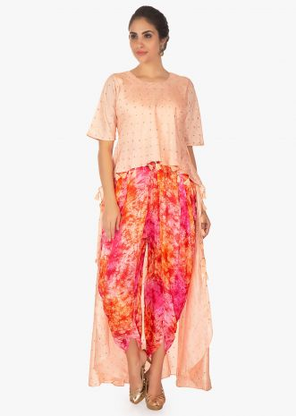 Front short back long peach blue top paired with multi color dhoti pant