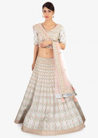 Frost blue  raw silk lehenga set paired with contrasting pink net dupatta