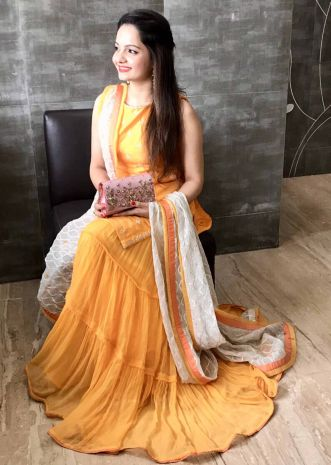 Gia Manek in Kalki chrome yellow embroidered suit with cotton skirt in gathers