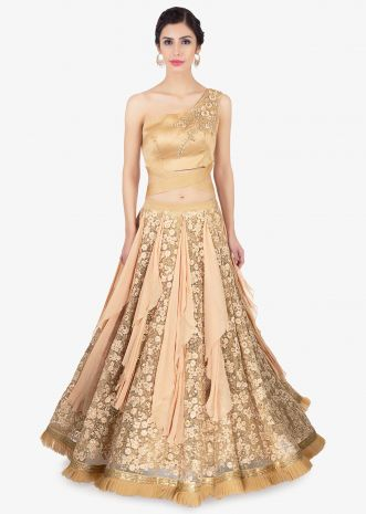 Golden lehenga in alternate kali paired with a one shoulder organza blouse