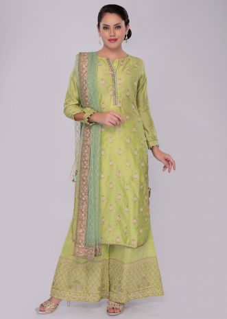 Green cotton silk palazzo suit set with net dupatta