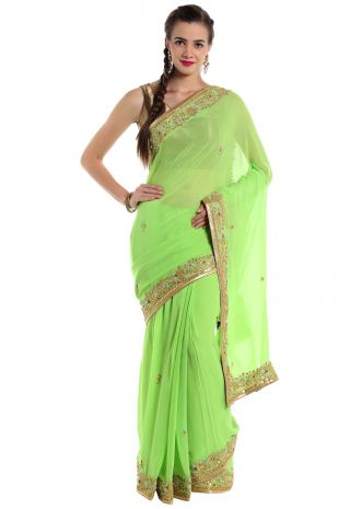 Green georgette saree adorned with gotta patch work  only on Kalki