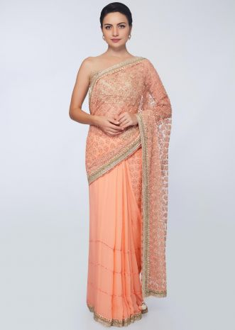 Half and half peach saree featuring in net and chiffon with crochet stripes along with embroidery and butti