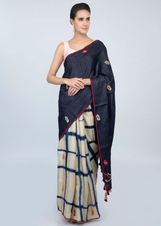 Half and tussar silk saree with batik print in checks and floral embroidered butti only on kalki