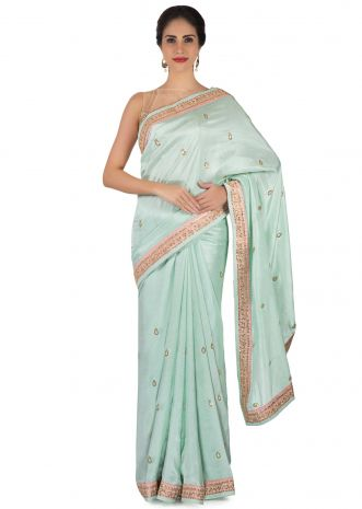 Ice blue saree in satin crepe in sequin butti and border only on Kalki