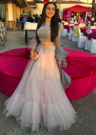 Powder pink sequins embroidered  net lehenga with grey georgette blouse and organza ruffled dupatta