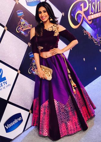 Kishwer Merchant in Kalki purple lehenga with shoulder cut blouse