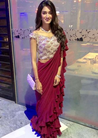 Erica Fernandes in Kalki plum saree in frill hem and pallo