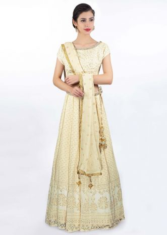 Ivory thread embroidered lehenga paired with a matching round neck blouse and chiffon dupatta