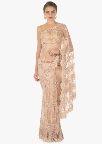 Latte cream embroidered net saree in sequin and moti